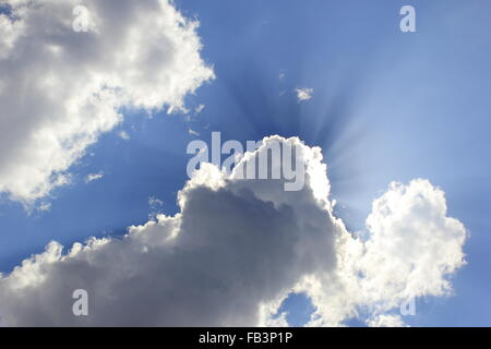 sunlight shining through cloud on the sky. - Stock Photo