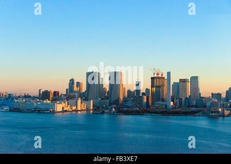 High rises along the waterfront in Tokyo Harbor at dawn, Tokyo, Japan - Stock Photo