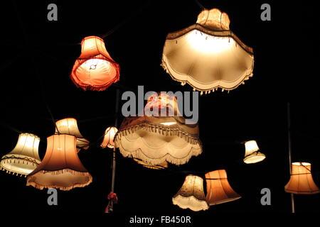 Vintage lights suspended in the dark, UK - Stock Photo