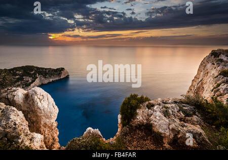 Beautiful sunset and rocks in Zakynthos shipwreck - Stock Photo