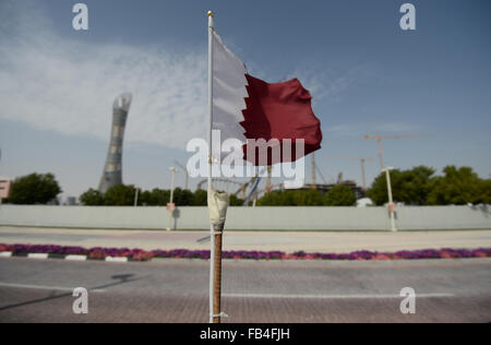 A Qatari flag flies in front of the construction site of the Khalifa International Stadium in Doha, 09 January 2016. - Stock Photo