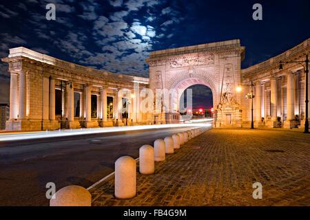 Illuminated Triumphal Arch and Colonnade of Manhattan Bridge Entrance in moonlight, Chinatown, Lower Manhattan, - Stock Photo
