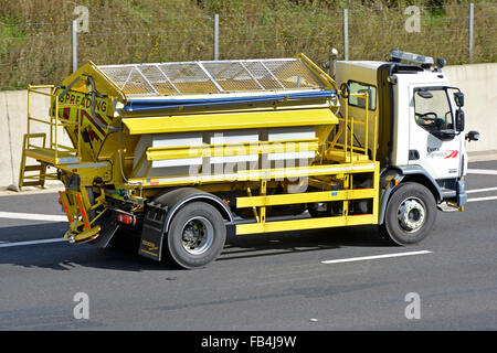 A new empty Econ road gritter unit mounted on a Daf chassis for Essex highways department driving along motorway - Stock Photo