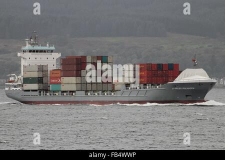 The container vessel X-Press Mulhacen approaching Cloch Point on the Firth of Clyde. - Stock Photo