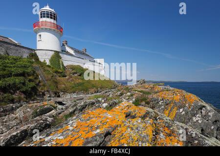 lighthouse at the Crookhaven Bay on Mizen peninsula, County Cork, Ireland - Stock Photo