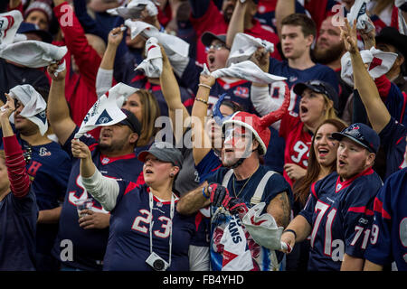 Houston, Texas, USA. 9th Jan, 2016. Houston Texans fans wave towls during the 1st quarter of an NFL playoff game - Stock Photo