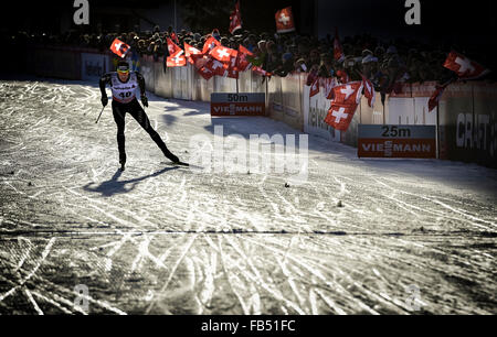 Cross-country skiers Dario Cologna, SUI, at finish line, FIS Cross-Country World Cup Davos, Switzerland - Stock Photo
