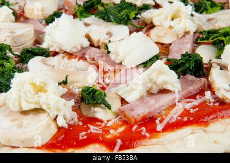 Raw Homemade  Pizza Ready to Bake - Stock Photo