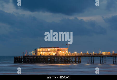 Worthing Pier lit up at night in Worthing, West Sussex, England, UK. - Stock Photo