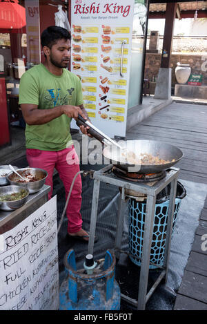 A cook frying rice at one of the small eateries at the Pettah floating market next to W E Bastian Mawatha, Colombo, - Stock Photo