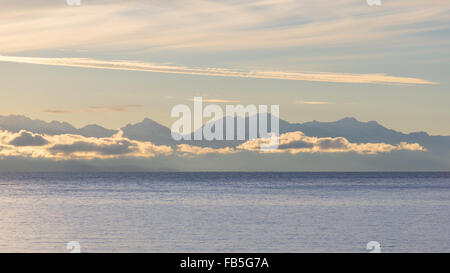 The majestic silhouette of the Cordillera Real mountain range at the horizon of the Titicaca Lake. Telephoto view - Stock Photo