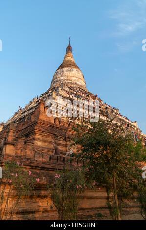 Shwesandaw pagoda in Bagan/Pagan, Mandalay Region, Myanmar, with tourists awaiting sunset. - Stock Photo