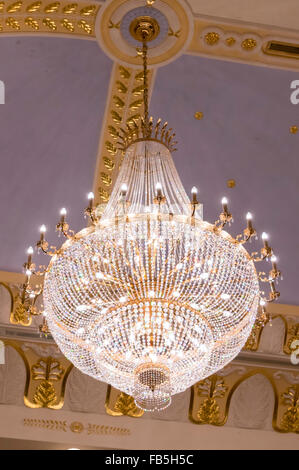 Large chandelier in the Royal Berkshire Hall of the Royal Brunei Polo & Riding Club, Jerudong, Sultanate of Brunei - Stock Photo