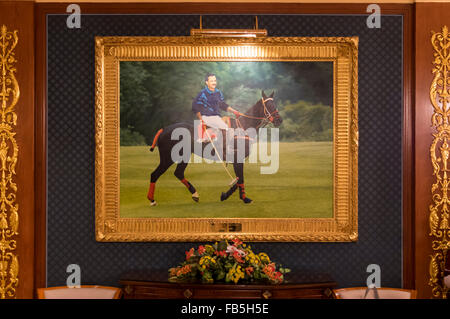 Framed picture of Haji Hassanal Bolkiah, the Sultan of Brunei Darussalam, riding his polo pony Chesney in Cirencester - Stock Photo