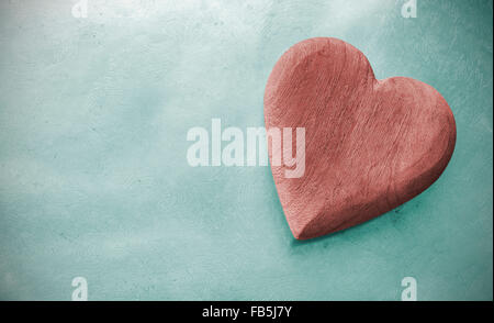 Vintage toned wooden heart on grunge background, space for text. - Stock Photo