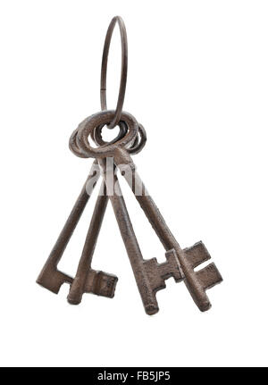 Set of old rusty antique keys over white background - Stock Photo