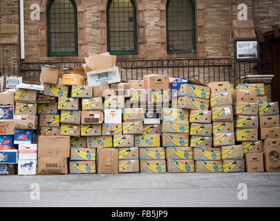 Cardboard boxes, mostly from Chiquita brand bananas, awaiting pick up and recycling in New York on Friday, January - Stock Photo