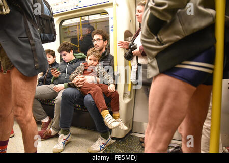 London, UK. 10th January 2016. No Trousers Tube Ride 2016, travellers remove their trousers on London Tube - Stock Photo