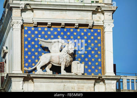Winged lion on facede of the bell tower at San Marco square in Venice, Italy - Stock Photo