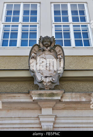 Ancient coat of arms on the outdoor wall of Festspielhaus (Great Festival Hall) in Salzburg, Austria - Stock Photo