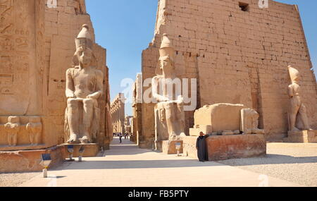 Colossi of Ramses II at the entrance to Luxor Temple, Luxor, Egypt - Stock Photo