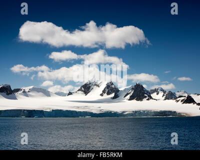 South Orkney Islands, Laurie Island coast, snow capped coastal mountains - Stock Photo