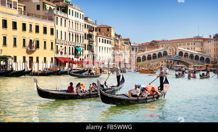 Gondola with tourists on Grand Canal, Venice cityscape, Veneto, Italy, UNESCO - Stock Photo
