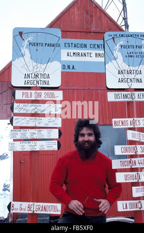 A bearded scientist welcomes Antarctica expedition visitors to the Almirante Brown Argentine research station located - Stock Photo