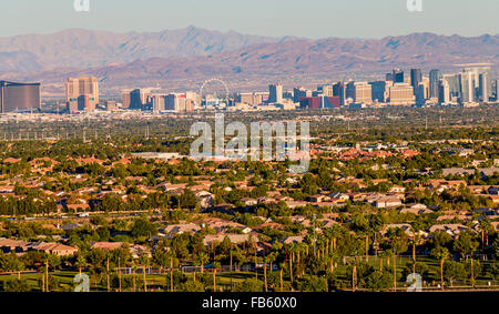The Las Vegas Strip viewed from afar with hotels and 550 foot High Roller wheel in view. - Stock Photo