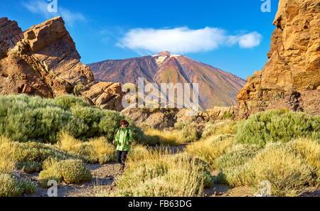 Tourist walking in Teide National Park, Tenerife, Canary Islands, Spain - Stock Photo
