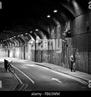 A person walking through a tunnel in London - Stock Photo