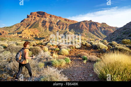 Nordic walking in Teide National Park, Tenerife, Canary Islands, Spain - Stock Photo