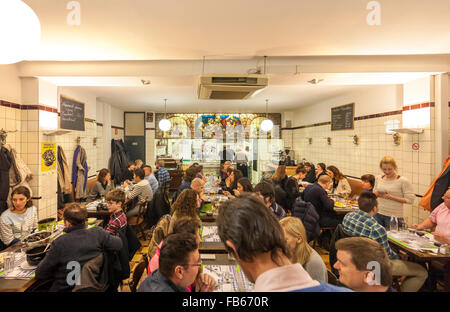 Brussels Restaurant Le Pré Salé interior with people eating mussels fries chips moules frites and other traditional - Stock Photo