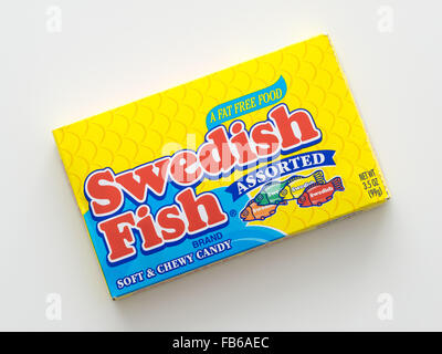 A box of swedish fish a fish shaped chewy candy Grape swedish fish