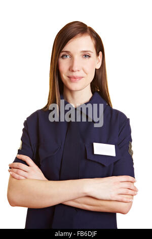 Portrait of a young female police officer with arms crossed - Stock Photo