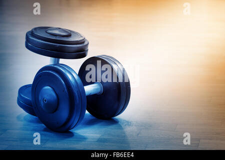 Two heavy weights on floor at the gym - Stock Photo
