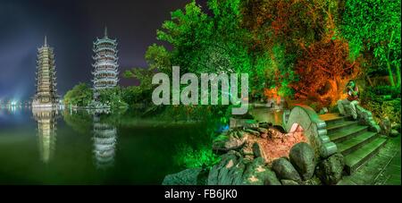 China, Guangxi Province, Guilin, Banyan Lake Pagodas. - Stock Photo
