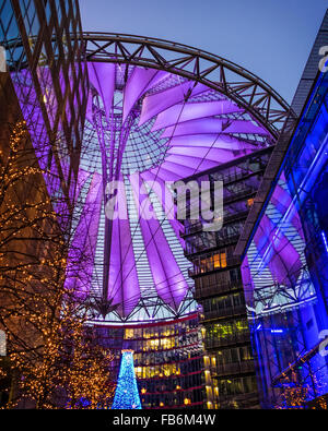 Christmas decorations and colourful lighting of roof of Sony Centre, Potsdamerplatz, Berlin - Stock Photo