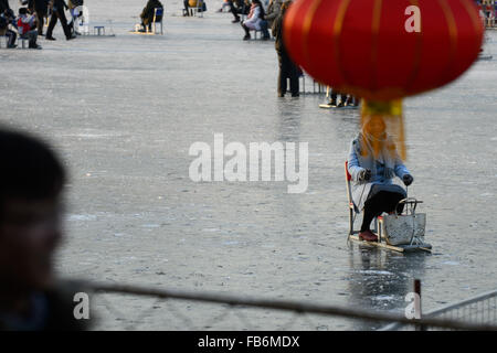 Beijing, China. 9th Jan, 2015. People have fun on a skating rink at Shichahai, a scenic area in Beijing, capital - Stock Photo