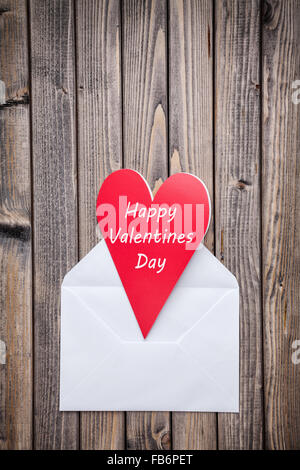 Romantic love letter on a wooden background - Stock Photo
