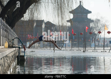 Beijing, China. 9th Jan, 2015. A winter-swimming lover jumps into Houhai of Shichahai, a scenic area in Beijing, - Stock Photo