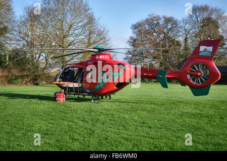 Presteigne, Powys, UK. The Wales Air Ambulance attends an incident in the town. A Eurocopter EC135 on the school - Stock Photo