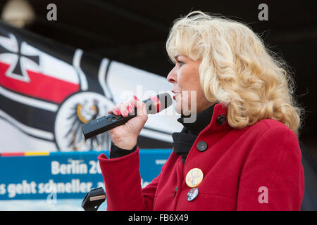 A 'German Woman' speaks at the Pegida manifestation. - Stock Photo