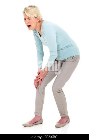 middle aged woman with knee pain isolated on white - Stock Photo