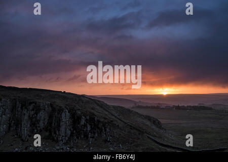 Winter sunrise over Peel Crag in Hadrian's Wall Country, Northumberland, England - Stock Photo