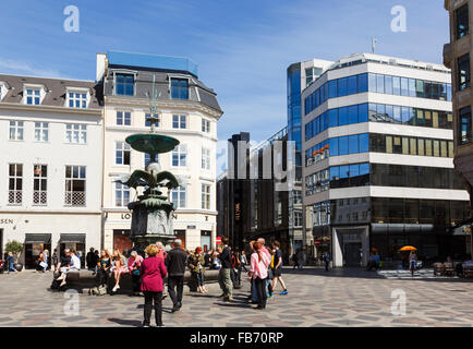 Old and new buildings in Amagertorv Square with Stork Fountain (Storkespringvandet) Amager Torv Strøget Copenhagen - Stock Photo