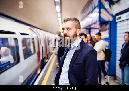 Young man in subway - Stock Photo