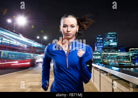Woman running in the city - Stock Photo
