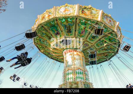 A French old-fashioned style carousel, carrousel, merry-go-round, Jardin d'Acclimatation, Bois de Boulogne, Paris, - Stock Photo