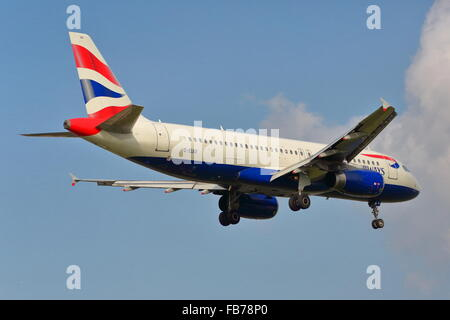 British Airways Airbus A320-232 G-EUUI landing at Heathrow - Stock Photo